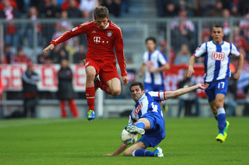 MUNICH, GERMANY - OCTOBER 15: Thomas Mueller (L) of Muenchen battles for the ball with Andre Mijatovic of Berlin during the Bundesliga match between FC Bayern Muenchen and Hertha BSC Berlin at Allianz Arena on October 15, 2011 in Munich, Germany. (Photo by Alexander Hassenstein/Bongarts/Getty Images)